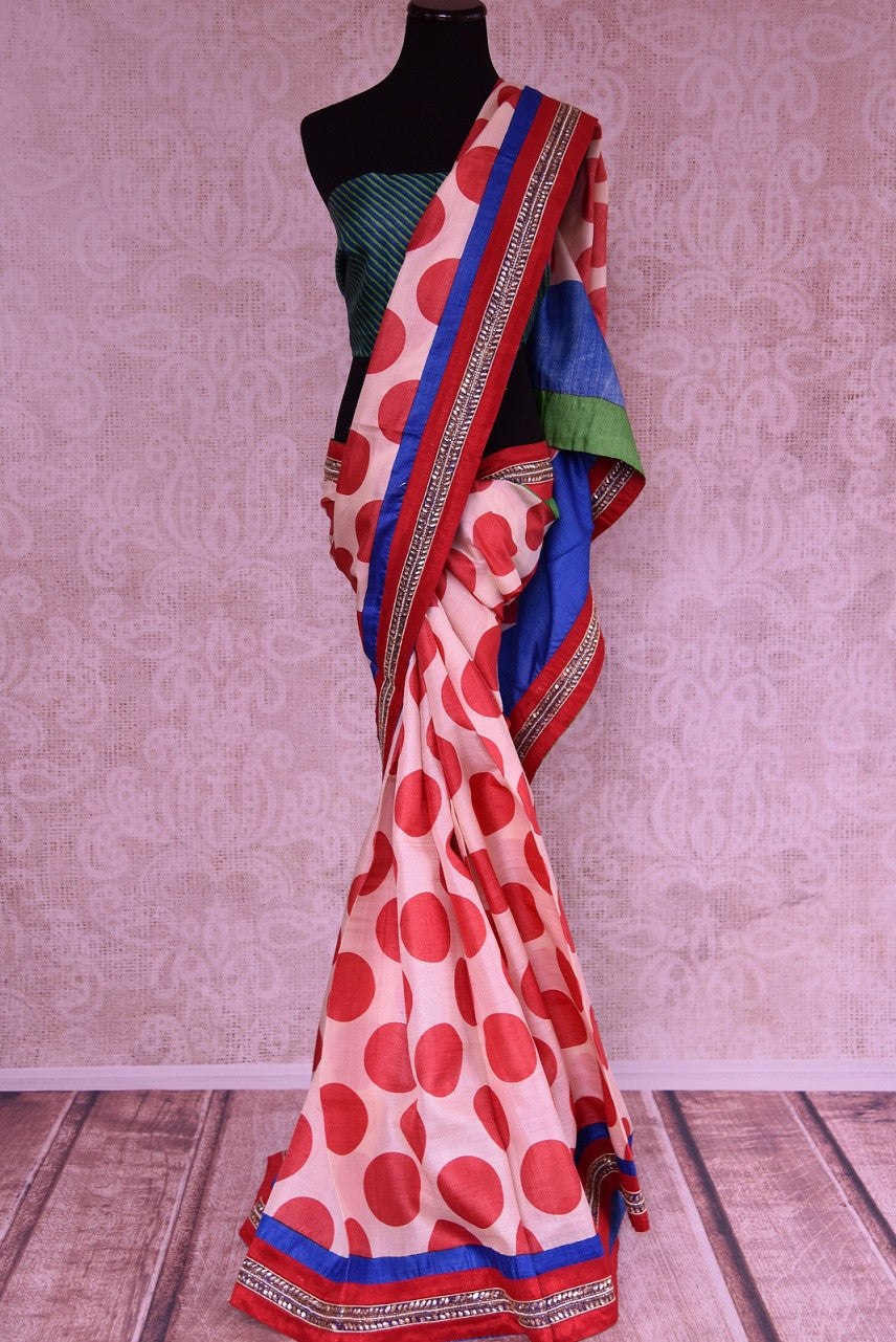 90C248 Looking for a unique party wear saree this season? Buy this multi-colored, printd silk saree with polka dots and a traditional kundan border trim, online at Pure Elegance.