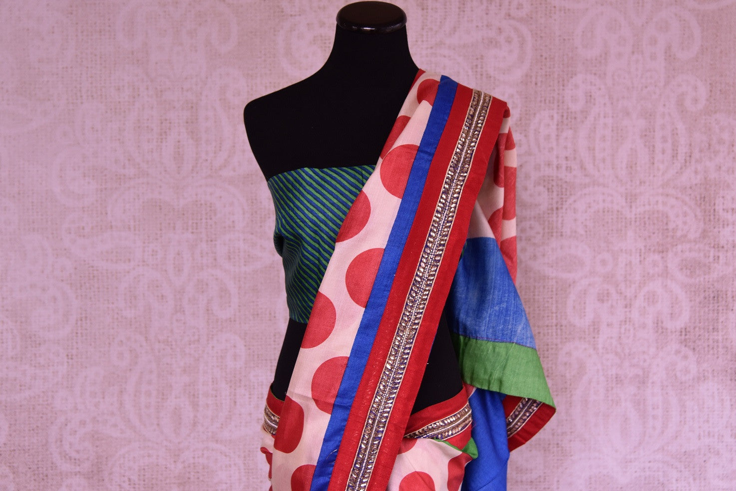 90C248 Looking for a unique party wear saree this season? Buy this multi-colored, printd silk saree with polka dots and a traditional kundan border trim today! This one is sure to keep your style game on top.