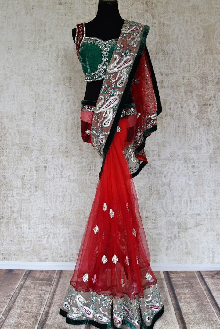 Buy red net saree online in USA with green embroidered border and saree blouse from Pure Elegance. Let your ethnic style be one of a kind with an exquisite variety of Indian designer sarees, pure silk sarees, Bollywood sarees from our exclusive fashion store in USA.-full view