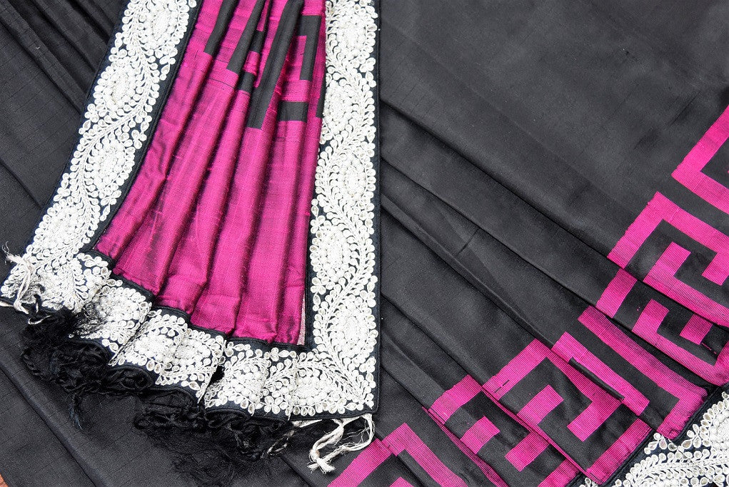 90C254 Bangalore silk saree with a black body, pink border and blouse and a striking jewel trim. This traditional saree with elements of modern design is ideal for Indian wedding functions like sangeet and reception & parties. Buy it at our Indian clothing store online in USA.