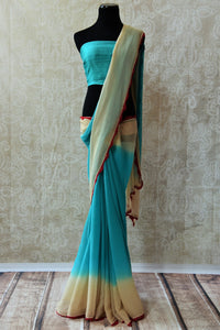 90C265 - Buy shaded chiffon saree online in USA at our Indian clothing store - Pure Elegance. This blue and cream saree is a lovely and simple ethnic Indian outfit. This plain saree is a versatile choice that can be styled in many ways!