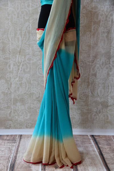 90C265 - Buy this lovely shaded chiffon saree online in USA at our Indian fashion store - Pure Elegance. This plain blue and cream saree is a lovely and simple ethnic Indian outfit, ideal for many functions.