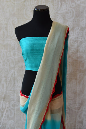 90C265 - Buy this lovely shaded chiffon saree online in USA at our Indian fashion store - Pure Elegance. This plain blue and cream saree is a lovely and simple Indian outfit that is a great choice for pujas and ethnic festivals.