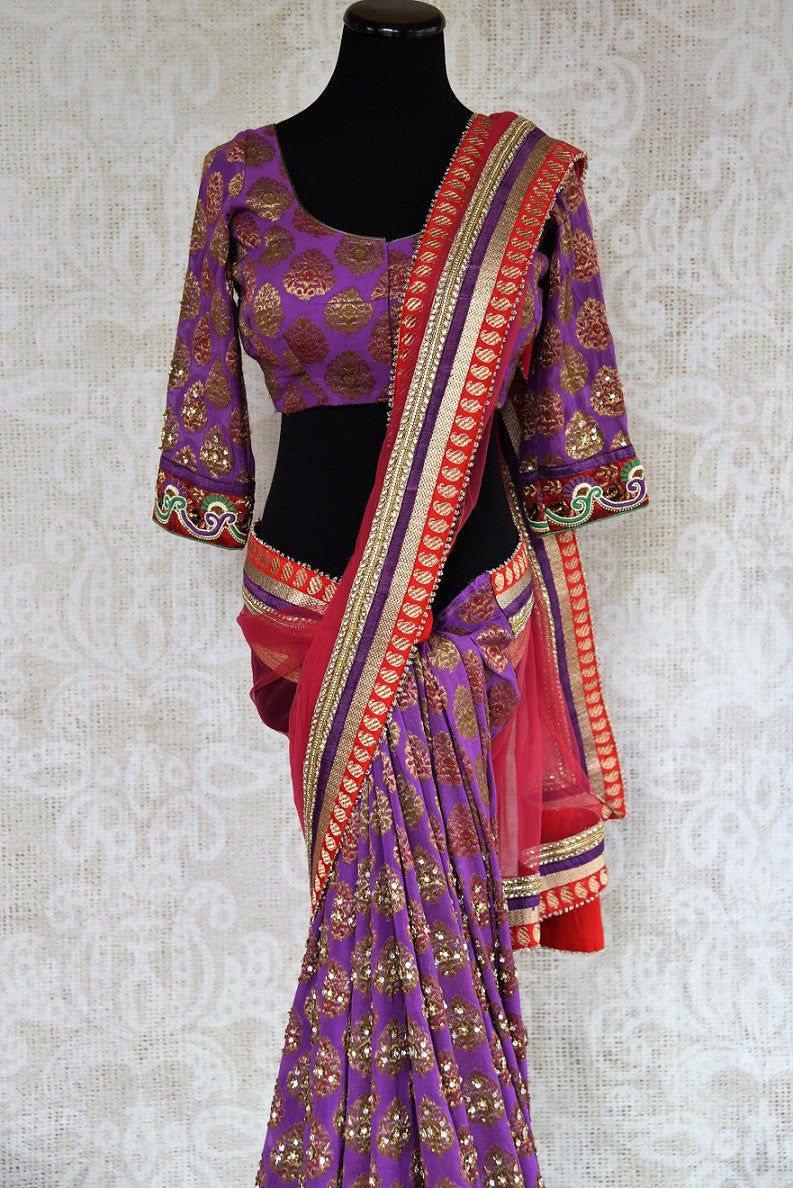 90C266 Traditional khaddi georgette saree with beautiful golden work. The red and purple embroidered sari makes for an evergreen Indian outfit for festive occasions and weddings. Buy this saree online in USA at our store Pure Elegance.