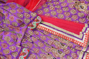 90C266 Traditional khaddi georgette saree with golden work. The purple embroidered sari with pops of red makes for a wonderful Indian outfit for festive occasions and weddings. Buy this saree online at Pure Elegance - our Indian clothing store.