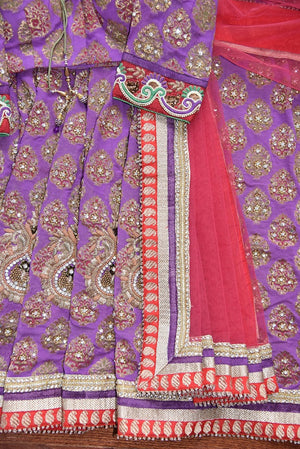 90C266 Lovely khaddi georgette saree with golden work. The red and purple embroidered sari makes for an ideal Indian outfit for festive occasions and weddings. Buy this lovely saree online at Pure Elegance today!