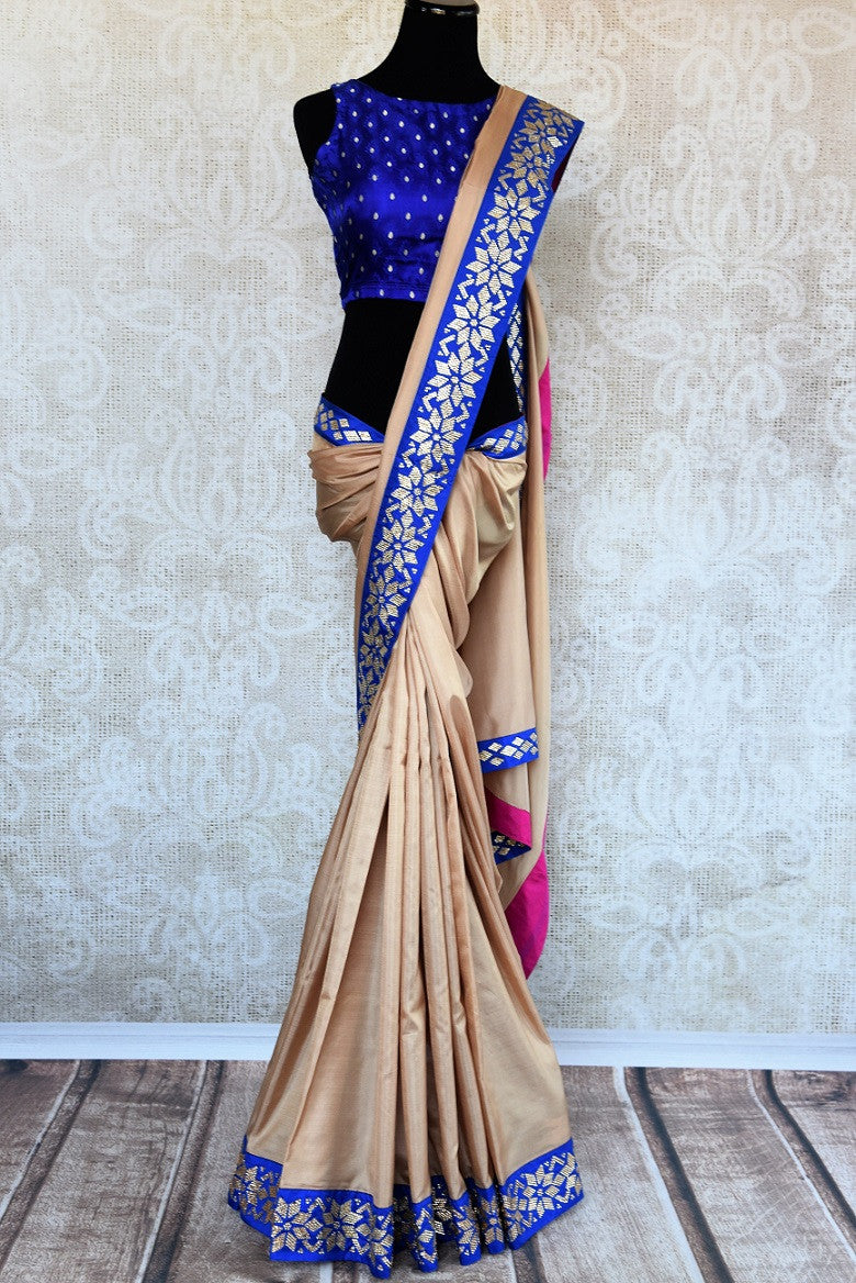 Buy beige saree online in USA with blue zircon border from Pure Elegance Indian fashion store in USA.-full view