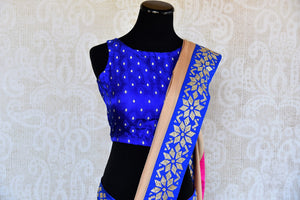 Buy beige saree online in USA with blue zircon border from Pure Elegance Indian fashion store in USA.-front