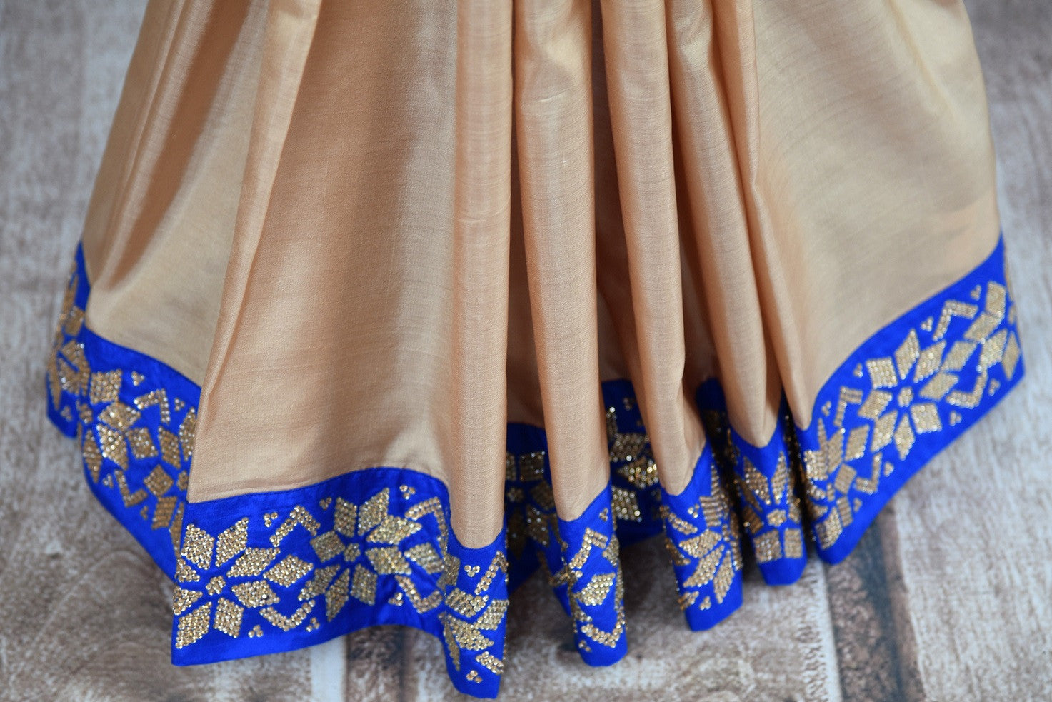 Buy beige saree online in USA with blue zircon border from Pure Elegance Indian fashion store in USA.-pleats