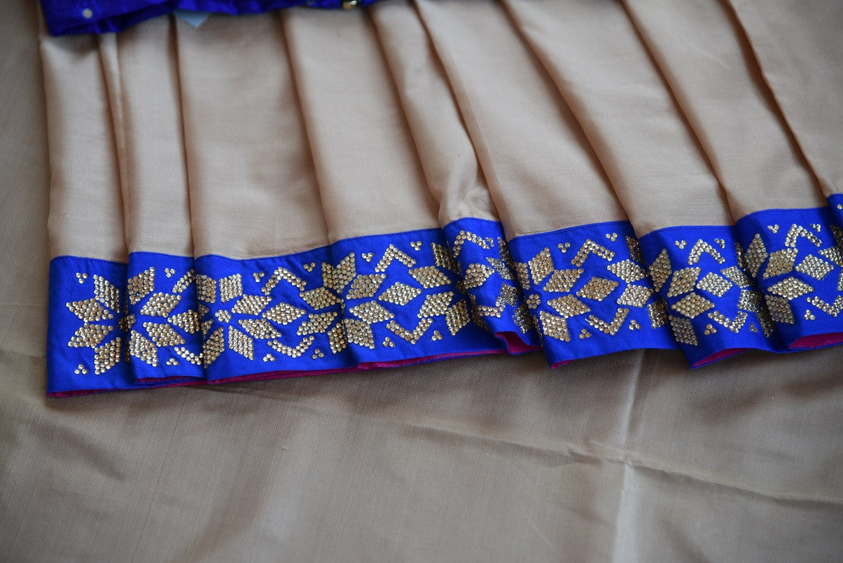 Buy beige saree online in USA with blue zircon border from Pure Elegance Indian fashion store in USA.-details