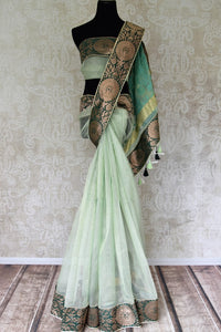 Buy sea green tissue handloom saree online in USA with Banarasi border from Pure Elegance online store. Visit our exclusive Indian clothing store in USA and get floored by a range of exquisite pure handloom sarees, Banarasi sarees, silk sarees, Indian jewelry and much more to complete your ethnic look.-full view