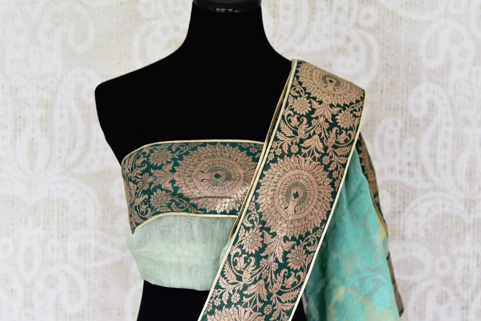 Buy sea green tissue handloom saree online in USA with Banarasi border from Pure Elegance online store. Visit our exclusive Indian clothing store in USA and get floored by a range of exquisite pure handloom sarees, Banarasi sarees, silk sarees, Indian jewelry and much more to complete your ethnic look.-blouse pallu
