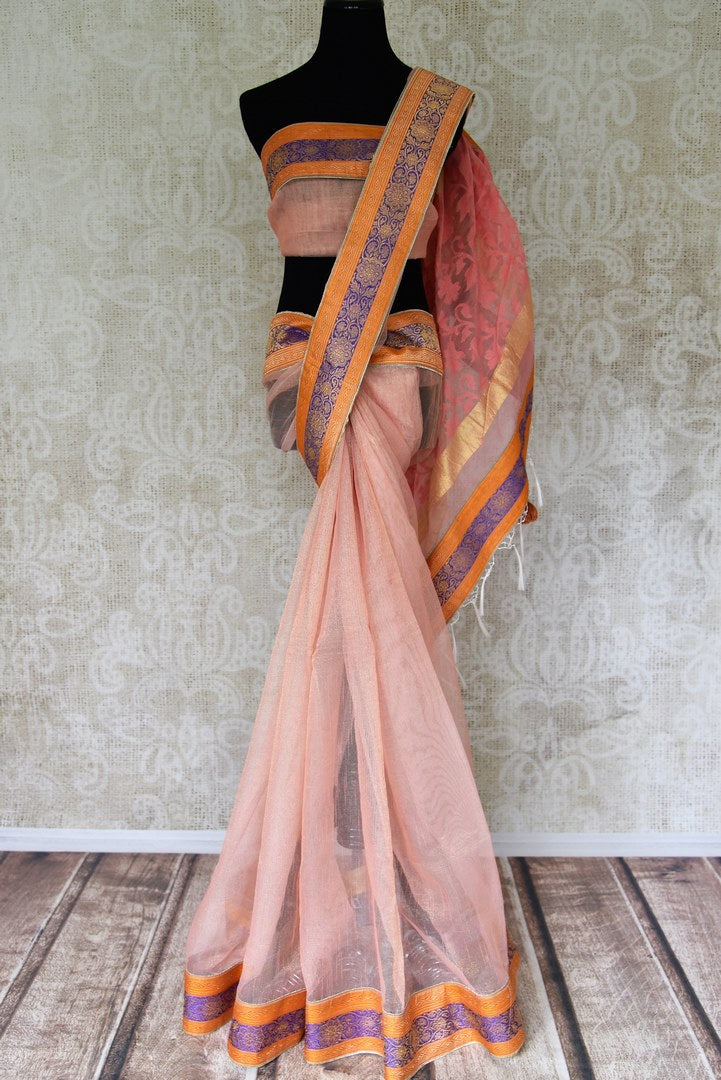 Shop peach tissue handloom sari online in USA with Banarasi border from Pure Elegance online store. Visit our exclusive Indian clothing store in USA and get floored by a range of exquisite pure handloom sarees, Banarasi sarees, silk sarees, Indian jewelry and much more to complete your ethnic look.-full view
