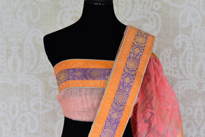 Shop peach tissue handloom sari online in USA with Banarasi border from Pure Elegance online store. Visit our exclusive Indian clothing store in USA and get floored by a range of exquisite pure handloom sarees, Banarasi sarees, silk sarees, Indian jewelry and much more to complete your ethnic look.-blouse pallu