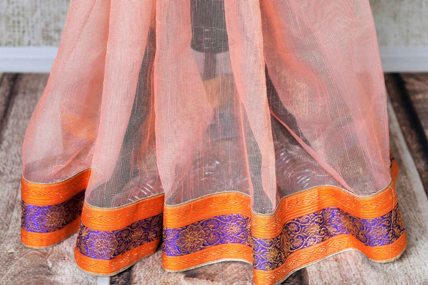 Shop peach tissue handloom sari online in USA with Banarasi border from Pure Elegance online store. Visit our exclusive Indian clothing store in USA and get floored by a range of exquisite pure handloom sarees, Banarasi sarees, silk sarees, Indian jewelry and much more to complete your ethnic look.-pleats