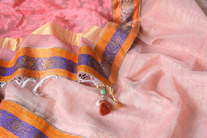 Shop peach tissue handloom sari online in USA with Banarasi border from Pure Elegance online store. Visit our exclusive Indian clothing store in USA and get floored by a range of exquisite pure handloom sarees, Banarasi sarees, silk sarees, Indian jewelry and much more to complete your ethnic look.-details