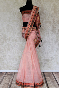 Shop pink jute sari online in USA with Banarasi border. Elevate your traditional style with exquisite Indian designer sarees from Pure Elegance Indian clothing store in USA. Explore a range of stunning silk sarees, embroidered sarees, wedding sarees especially from India for women in USA.-full view