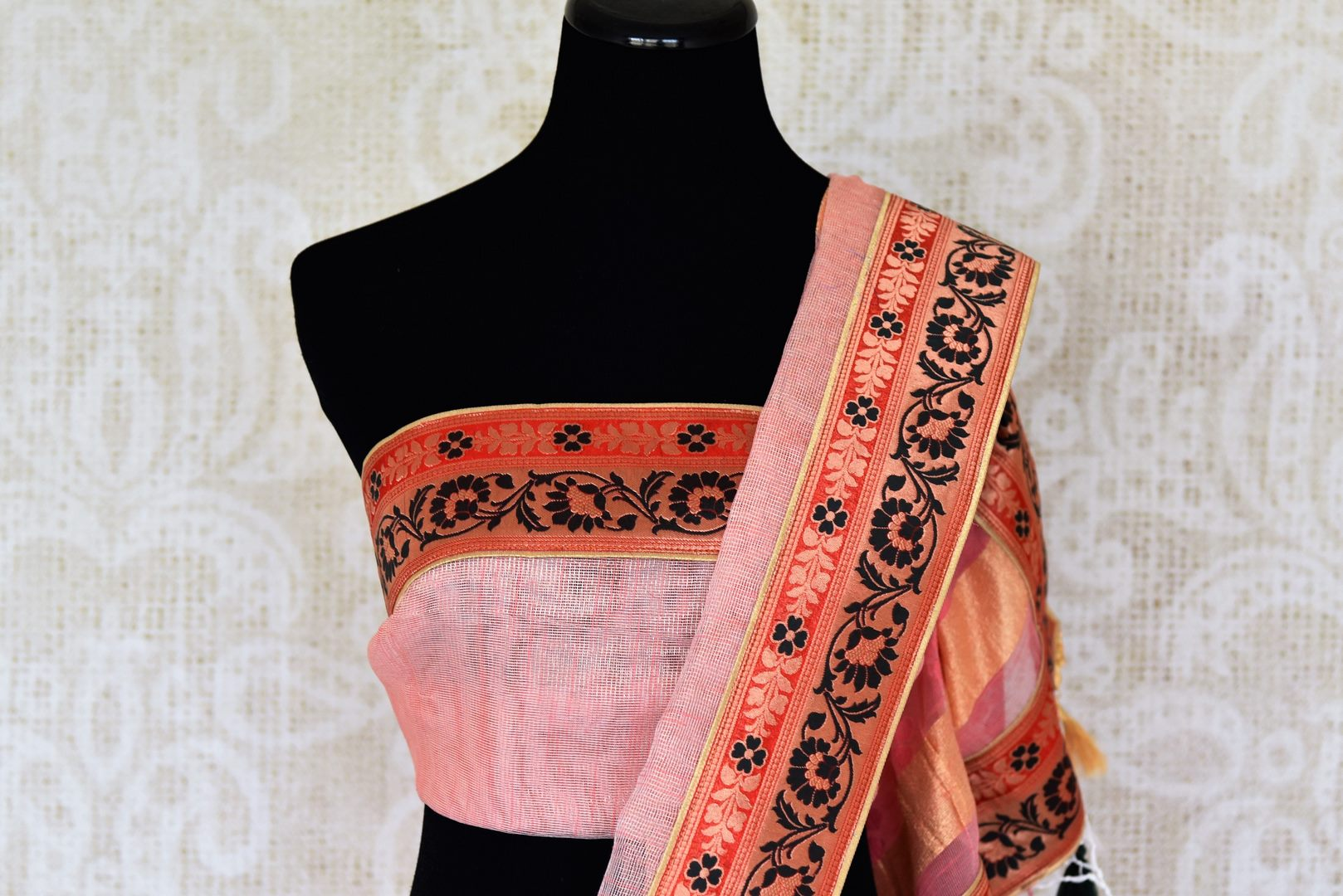 Shop pink jute sari online in USA with Banarasi border. Elevate your traditional style with exquisite Indian designer sarees from Pure Elegance Indian clothing store in USA. Explore a range of stunning silk sarees, embroidered sarees, wedding sarees especially from India for women in USA.-blouse pallu