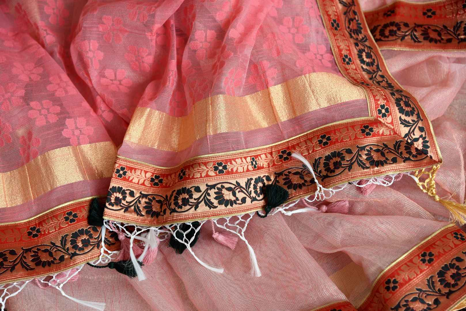 Shop pink jute sari online in USA with Banarasi border. Elevate your traditional style with exquisite Indian designer sarees from Pure Elegance Indian clothing store in USA. Explore a range of stunning silk sarees, embroidered sarees, wedding sarees especially from India for women in USA.-details