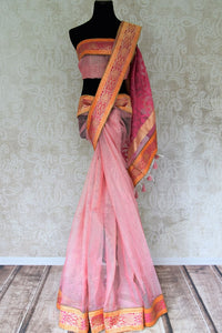 Buy pink and gold tissue handloom sari online in USA with Banarasi border from Pure Elegance online store. Visit our exclusive Indian clothing store in USA and get floored by a range of exquisite pure handloom sarees, Banarasi sarees, silk sarees, Indian jewelry and much more to complete your ethnic look.-full view