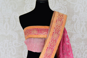 Buy pink and gold tissue handloom sari online in USA with Banarasi border from Pure Elegance online store. Visit our exclusive Indian clothing store in USA and get floored by a range of exquisite pure handloom sarees, Banarasi sarees, silk sarees, Indian jewelry and much more to complete your ethnic look.-blouse pallu