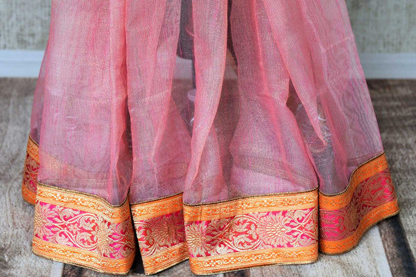 Buy pink and gold tissue handloom sari online in USA with Banarasi border from Pure Elegance online store. Visit our exclusive Indian clothing store in USA and get floored by a range of exquisite pure handloom sarees, Banarasi sarees, silk sarees, Indian jewelry and much more to complete your ethnic look.-pleats