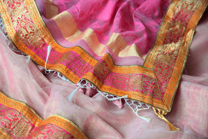 Buy pink and gold tissue handloom sari online in USA with Banarasi border from Pure Elegance online store. Visit our exclusive Indian clothing store in USA and get floored by a range of exquisite pure handloom sarees, Banarasi sarees, silk sarees, Indian jewelry and much more to complete your ethnic look.-details