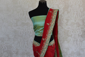 90c518 Traditional red saree with golden work and green blouse perfect for Indian weddings. Buy this ethnic Georgette saree online at Pure Elegance - our Indian wear store in USA.
