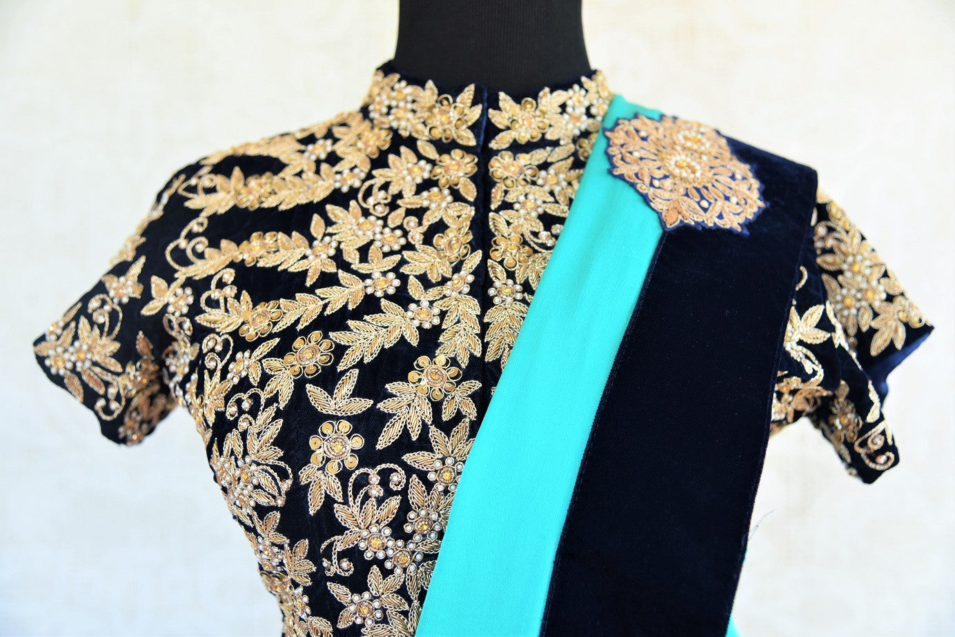 Black solid velvet ethnic Indian designer blouse from Pure Elegance with heavy zari and bead work is perfect for any wedding. Buy online or from our USA store. Front View.