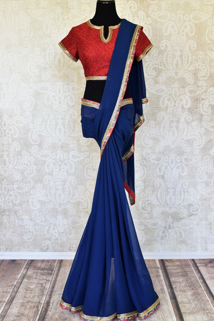 Shop blue embroidered georgette saree online in USA with red saree blouse from Pure Elegance. Let your ethnic style be one of a kind with an exquisite variety of Indian designer sarees, pure silk sarees, Bollywood sarees from our exclusive fashion store in USA.-full view