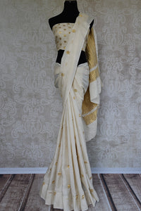 Tussar Banarasi saree in white with gold crinkled banarasi pallu. Ethnic as well as contemporary saree.-full view