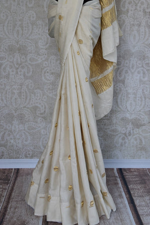 Tussar Banarasi saree in white with gold crinkled banarasi pallu. Ethnic as well as contemporary saree.-pleats