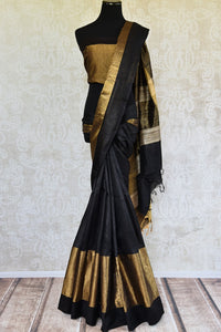 Traditional and bold black Bhagalpur tussar saree with ethnic gold border. Perfect saree for Indian events. -Full view