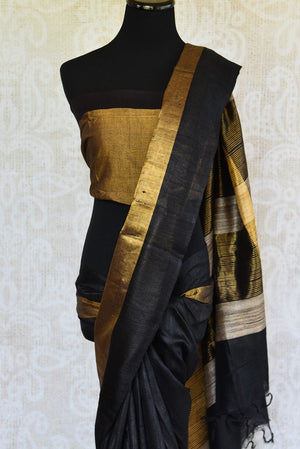 Traditional and bold black Bhagalpur tussar saree with ethnic gold border. Perfect saree for Indian events. -pallu