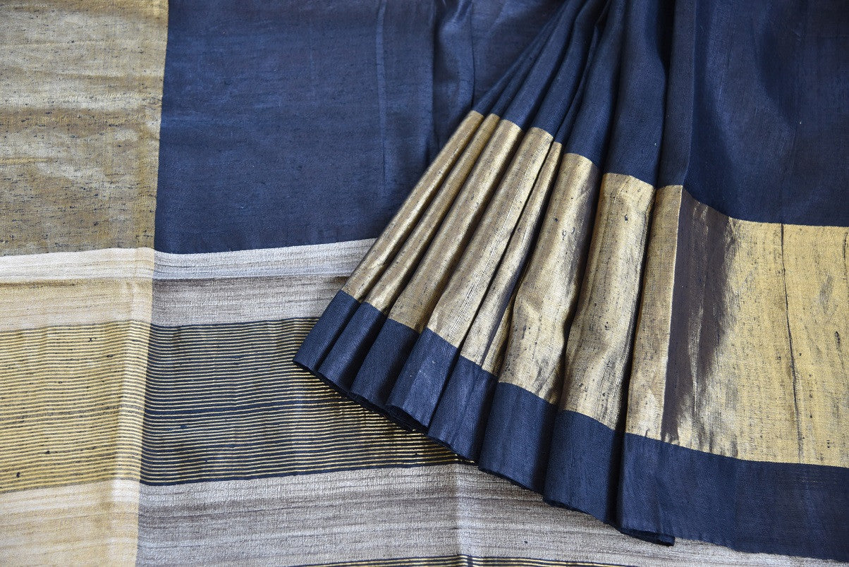 Traditional and bold black Bhagalpur tussar saree with ethnic gold border. Perfect saree for Indian events. -close up