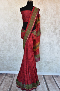 90C723 Traditional red sari ideal for small funtions available at our ethnic wear store. The printed, chanderi sari will be a great addition to your Indian wardrobe. Charming and classic, this saree is a keeper!