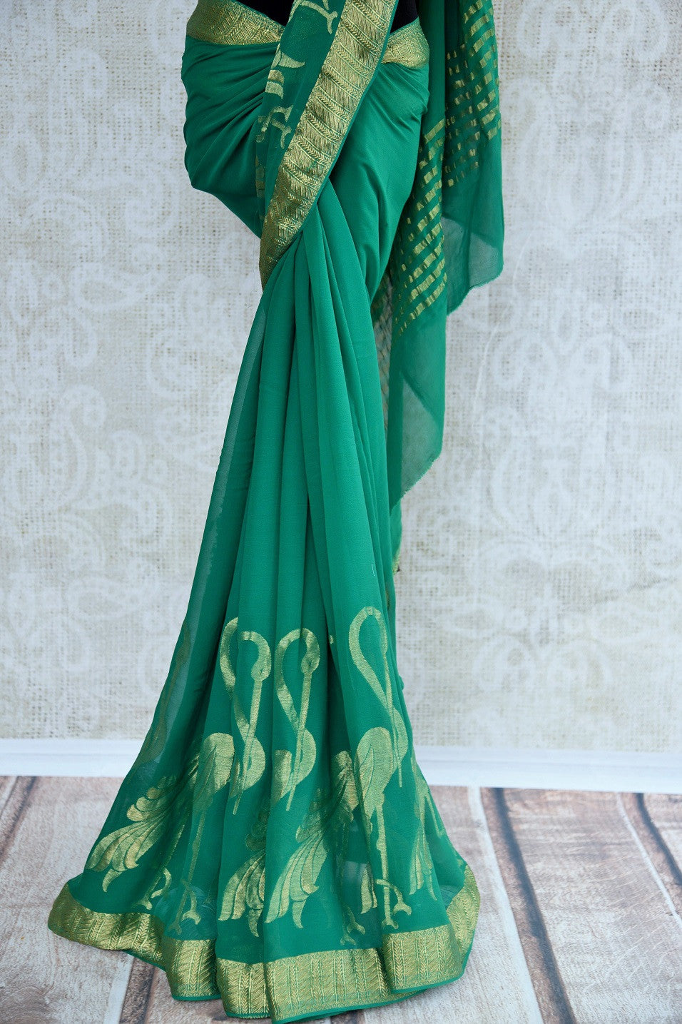 Shop green and gold sari in georgette zari with gold border online at  Pure-Elegance in USA.This Indian silk sari can be a party wear, wedding, or bridal sari.
