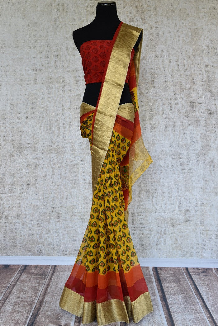 Buy yellow printed chiffon saree online in USA with gold border. Shop from an exquisite range of Indian designer sarees at Pure Elegance online or visit our clothing store in USA.-full view