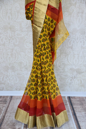 Buy yellow printed chiffon saree online in USA with gold border. Shop from an exquisite range of Indian designer sarees at Pure Elegance online or visit our clothing store in USA.-pleats