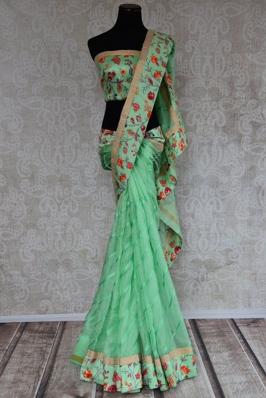 90C841 Minty green kota saree with a similar colored raw silk border that is an ideal Indian outfit for weddings and festive occasions. Buy this floral saree online in USA at our store - Pure Elegnce.