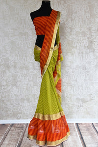 Shop green and orange georgette sari in geometrical print online at Pure-Elegance in USA. This printed Indian silk saree is ideal for party wear and wedding.