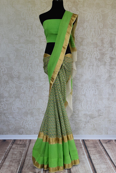 Detailed Printed georgette saree in green color. Glamourous addition in your summer collection of sarees.-Full View