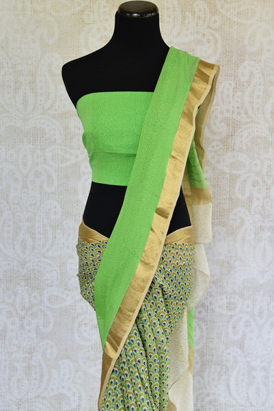 Detailed Printed georgette saree in green color. Glamourous addition in your summer collection of sarees.-pallu