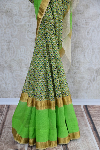 Detailed Printed georgette saree in green color. Glamourous addition in your summer collection of sarees.-pleats