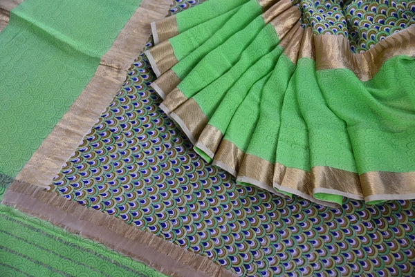 Detailed Printed georgette saree in green color. Glamourous addition in your summer collection of sarees.-close up