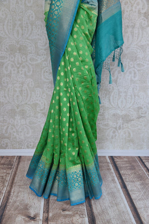 Light green muga silk saree for online shopping in USA. Pure Elegance clothing store brings an exquisite variety of beautiful Indian sarees in USA. Shop online.-pleats