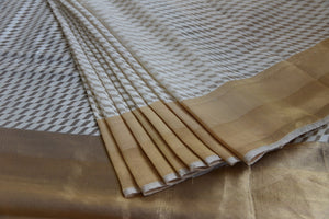 90C942 White and Gold Tissue Jute Saree