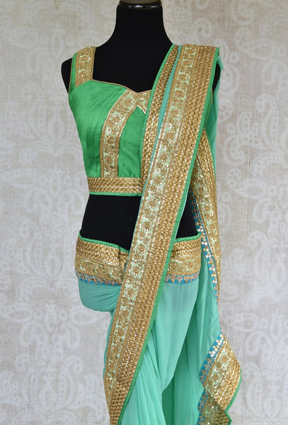 90C958 Blue & Green Georgette Saree With Zari Work