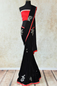 Black embroidered velvet saree with raw silk red and gold trim border.Perfect party saree for Indian evening parties.-Full view