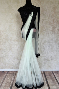 Buy white embroidered net saree online in USA with black beaded blouse from Pure Elegance. Let your ethnic style be one of a kind with an exquisite variety of Indian designer sarees, pure silk sarees, Bollywood sarees from our exclusive fashion store in USA.-full view